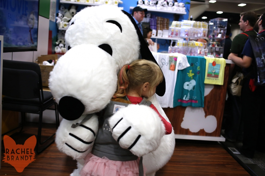 Little Girl Hugs Snoopy From Peanuts