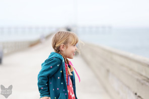 Girl looks out over the Pacific Ocean in San Diego California